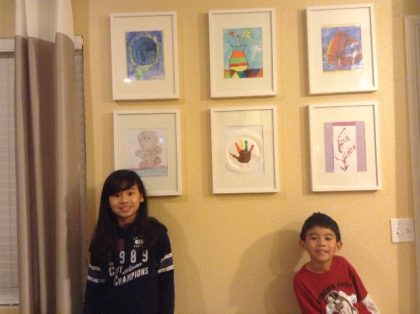 Emily and Nicholas with their art